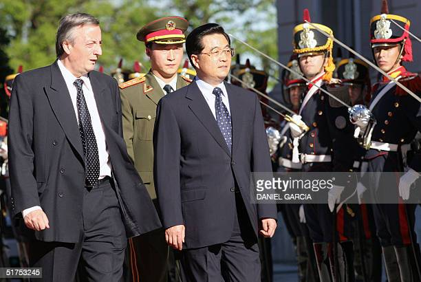 Argentine Presidente Nestor Kirchner and China's President Hu Jintao review the guard of honour at the entrance of the Government House in Buenos...