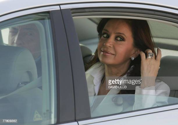 Argentine presidentelect first lady Cristina Fernandez tides her hair after arriving with her husband president Nestor Kirchner at Santiago's airport...