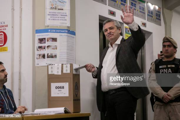 Argentine Presidential candidate Alberto Fernandez waves to the press while casts his vote during the Simultaneous and Mandatory Open Primaries on...