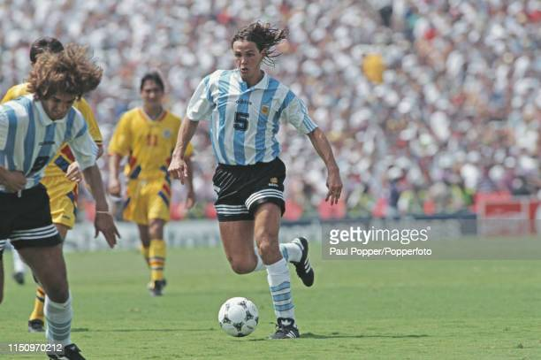 Argentine professional footballer Fernando Redondo midfielder with Tenerife pictured making a run with the ball during play between Romania and...