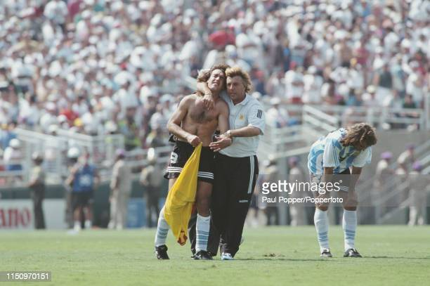 Argentine professional footballer Gabriel Batistuta striker with Fiorentina is consoled by a member of the Argentina coaching squad after Argentina...