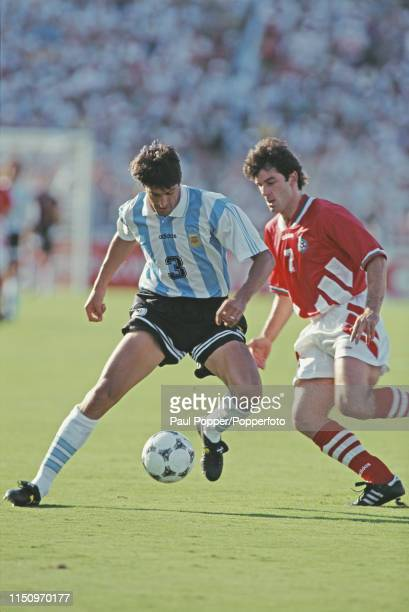 Argentine professional footballer Jose Chamot, defender with Foggia, pictured with the ball as Bulgarian striker Emil Kostadinov moves in to tackle...