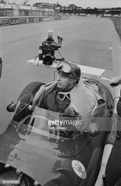 Argentine racing car driver Juan Manuel Fangio shooting an autobiographical movie at Silverstone 5th October 1970 Behind him a camera belonging to...