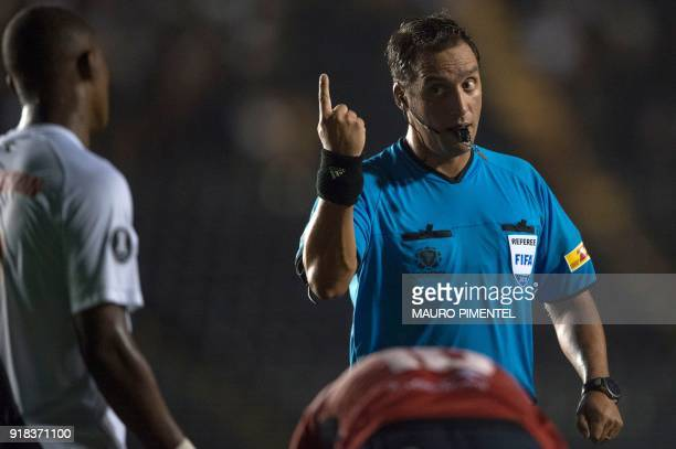 Argentine referee Fernando Andres Rapallini gestures during the Libertadores Cup football match between Brazil's team Vasco da Gama and Bolivia's...