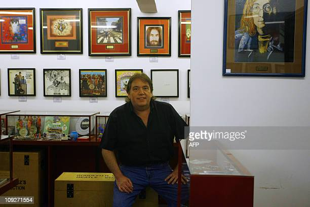 Argentine Rodolfo Vazquez who is in the Guinness Book of Records for owning the biggest Beatles collection in the world some 8500 pieces poses at the...