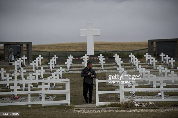 Argentine Sebastian Socodo walks among tombstones at Argentine cementery in the Falkland Islands on March 27 2012 April 2 2012 commemorates the 30th...