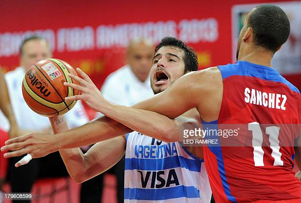 Argentine Selem Safar vies for the ball with Puerto Rican Ricardo Sanchez during their Spain 2014 FIBA World Cup qualifier game in Caracas on...