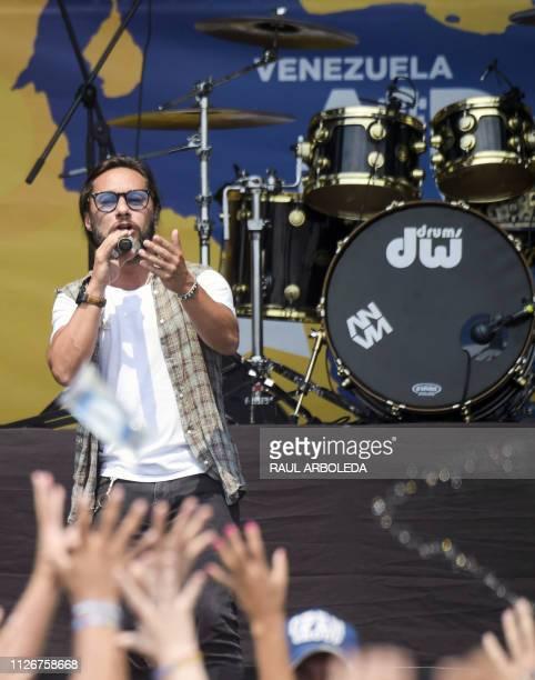 Argentine singer Diego Torres performs during Venezuela Aid Live concert organized to raise money for the Venezuelan relief effort at Tienditas...