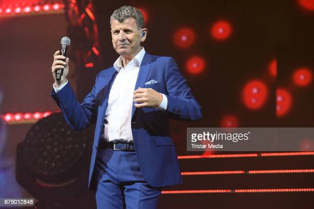 Argentine singer Semino Rossi performs during 'Die Schlagernacht des Jahres' at Lanxess Arena on April 29 2017 in Cologne Germany