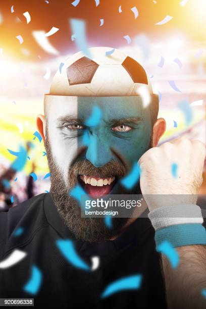 Argentine soccer fan with football inside the head