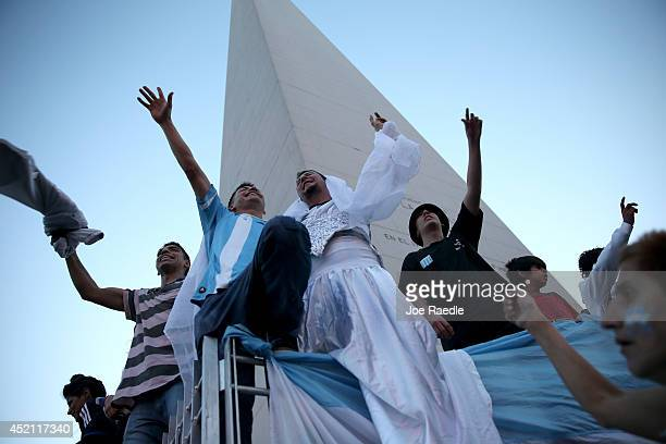 Argentine soccer fans cheer near the Obelisco de Buenos Aires after the World Cup final on July 13 2014 in Buenos Aires Argentina Germany won 10 for...