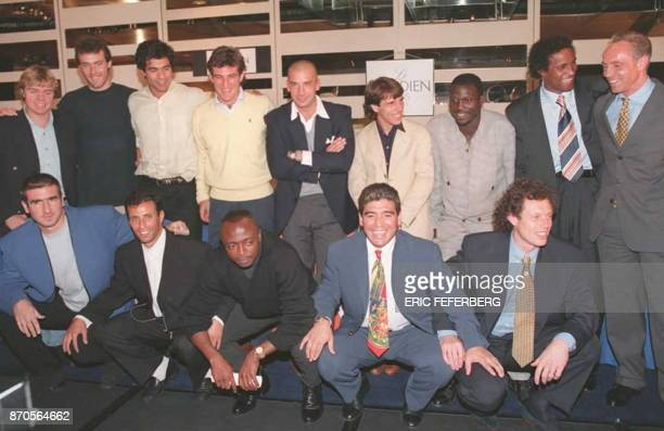 Argentine soccer great Diego Armando Maradona poses 18 September in Paris with other players after unveiling plans for a worldwide soccer players...