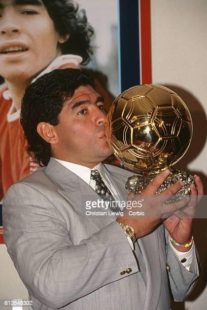 "Argentine soccer legend Diego Maradona receiving an honorary ""Ballon d'Or""."