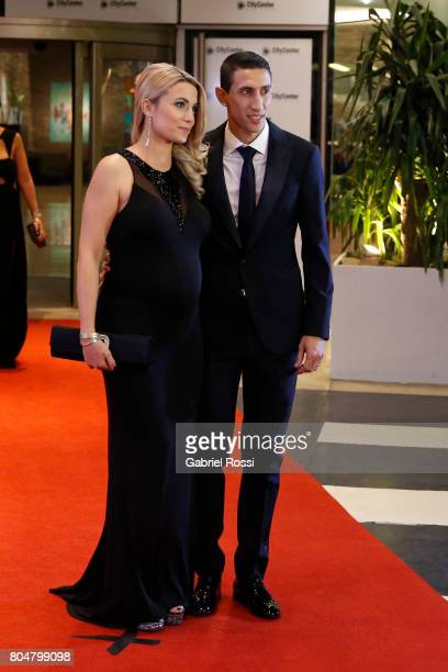 Argentine soccer player Angel Di María and his wife Jorgelina Cardoso pose for pictures on the red carpet during Lionel Messi and Antonela Rocuzzo's...