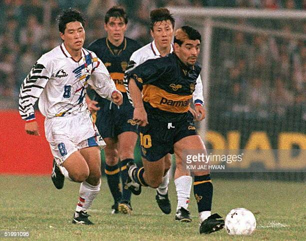 Argentine soccer player Diego Maradona is chased by South Korea's Roh SangRae during the second half of his victorious 21 comeback match with Boca...