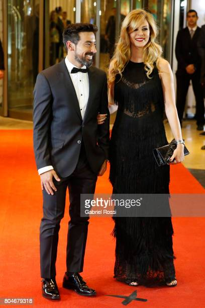 Argentine soccer player Ezequiel Lavezzi and his girlfriend Yanina Screpante pose for pictures on the red carpet during Lionel Messi and Antonela...