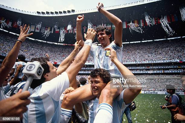 Argentine soccer player Jorge Burruchaga is hoisted on the shoulders of a teammate following Agentina's 32 win over West Germany in the 1986 FIFA...