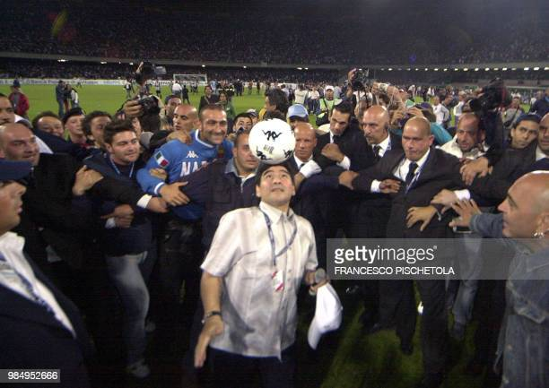 Argentine soccer star Diego Armando Maradona plays with a soccer ball at San Paolo stadium in Naples 09 June 2005 Thousand fans greeted their former...