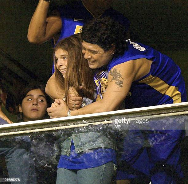 Argentine soccer star Diego Maradona hugs his daughter Dalma 28 June 2001 during the Copa Libertadores final between Argentina's Boca Juniors and...