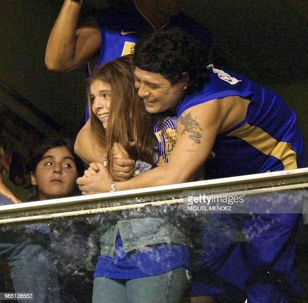 Argentine soccer star Diego Maradona hugs his daughter Dalma 28 June 2001 during the Copa Libertadores final between Argentina's Boca Juniors and...
