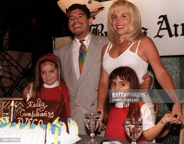 Argentine soccer star Diego Maradona poses with his wife Claudia and his two daughters Giannina and Dalma during a ceremony late 30 October...