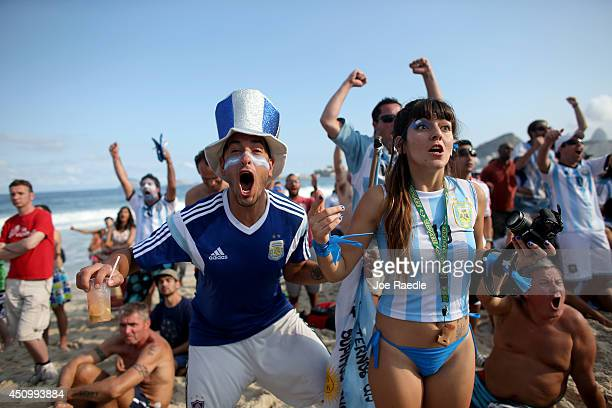 Argentine soccer team fans react to their team scoring against the Iran team as they watch on the screen setup at the Word Cup FIFA Fan Fest during...
