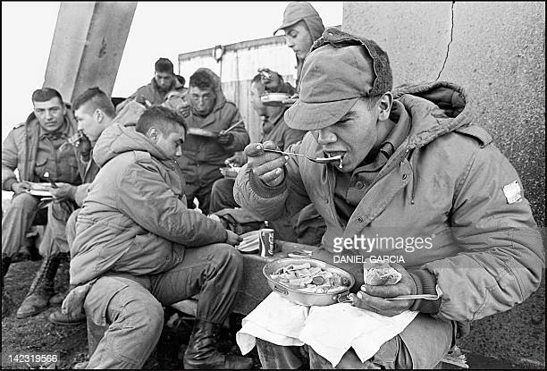 Argentine soldiers have lunch at the partially destroyed former Royal Marines base 13 April 1982 Twentyfive years after the Falklands/Malvinas war...