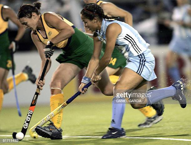 Argentine Soledad Garcia battles for the ball with Australian Emily Halliday during the field hockey match for the Champions Trophy in Rosario...
