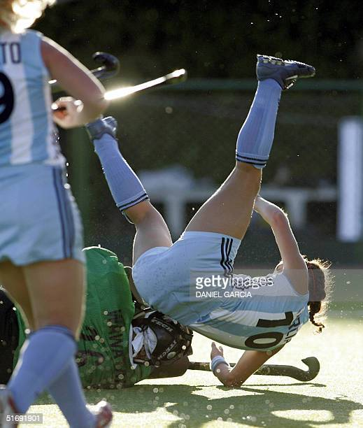Argentine Soledad Garcia lands after colliding with New Zealand's goalkeeper Anita Wawatai during the field hockey match of the Champions Trophy in...