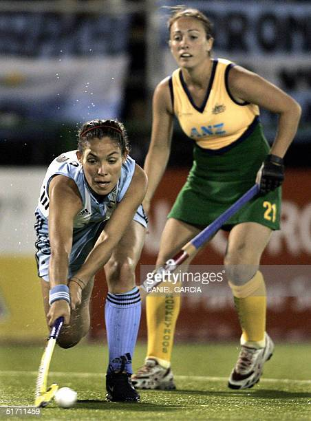 Argentine Soledad Garcia takes the ball after passing Australian Hope Brown during the field hockey match for the Champions Trophy in Rosario...