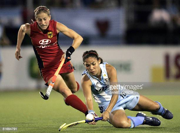 Argentine Soledad Garcia tries to control the ball in front of German Marion Rodewald during the field hockey match during the Champions Trophy in...