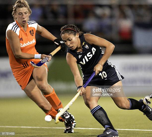 Argentine Soledad Garcia tries to pass Dutch Chantal de Bruijn during a field hockey match for the Champions Trophy in Rosario Argentina 11 November...