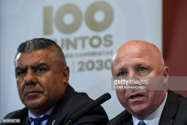 Argentine Sports Secretary and former footballer Carlos Javier Mac Allister speaks next to Argentine Football Association President Claudio Tapia...
