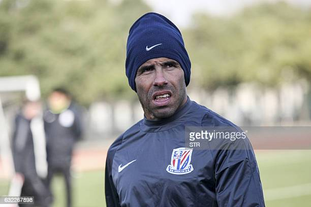 Argentine striker Carlos Tevez takes part in his first training session with his new club Shanghai Shenhua in Shanghai on January 21 2017 / AFP / STR...