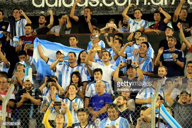 Argentine supporters cheer up during the FIFA 2018 World Cup Qualifiers football match between Argentina and Chile at Monumental Stadium on March 23...