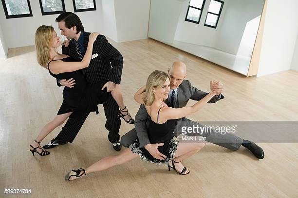 Argentine tango dancers practicing in a ballroom