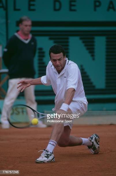 Argentine tennis player Franco Squillari pictured in action to lose to Andre Agassi in the first round of the Men's Singles tournament at the 1999...