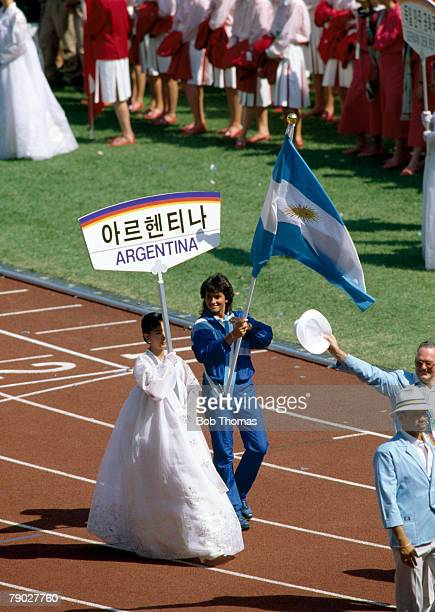 Argentine tennis player Gabriela Sabatini carries her country's national flag during the opening ceremony of the 1988 Summer Olympics inside the...