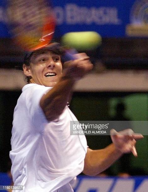 Argentine tennis player Gaston Gaudio hits the ball in Rio de Janeiro Brazil 03 January 2002 El tenista argentino Gaston Gaudio ataca la pelota...