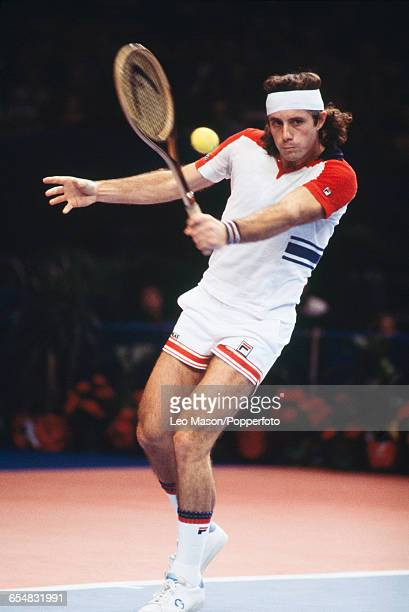 Argentine tennis player Guillermo Vilas pictured in action competing in the Men's Singles tournament at the 1978 Benson & Hedges Championships at...