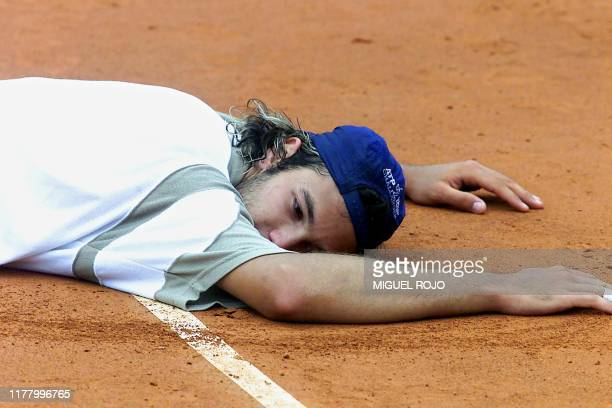 Argentine tennis player Jose Acasuso collapses after losing the final match in the Ericsson Cup to Guillermo Coria 19 November 2000 in Montevideo...