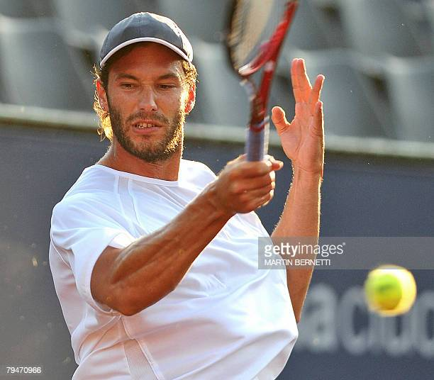 Argentine tennis player Jose Acasuso returns the ball to Uruguay's Pablo Cuevas during their ATP Open quarterfinal match in Vina del Mar Chile on...