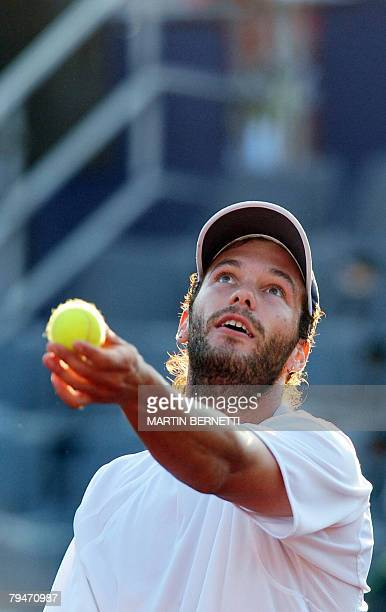 Argentine tennis player Jose Acasuso serves the ball to Uruguay's Pablo Cuevas during their ATP Open quarterfinal match in Vina del Mar Chile on...
