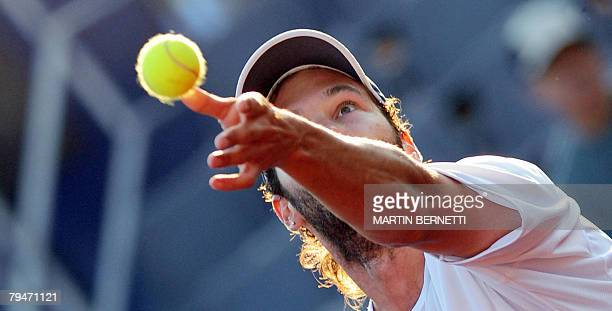 Argentine tennis player Jose Acasuso serves the ball to Uruguay's Pablo Cuevas during their ATP Open quarterfinal match in Vina del Mar, Chile on...