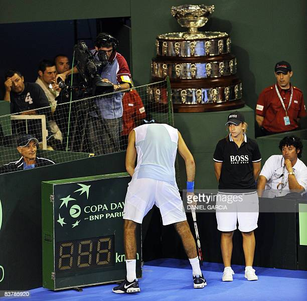 Argentine tennis player Juan Martin Del Potro asks for medical care during his Davis Cup 2008 World Group final match against Spaniard Feliciano...