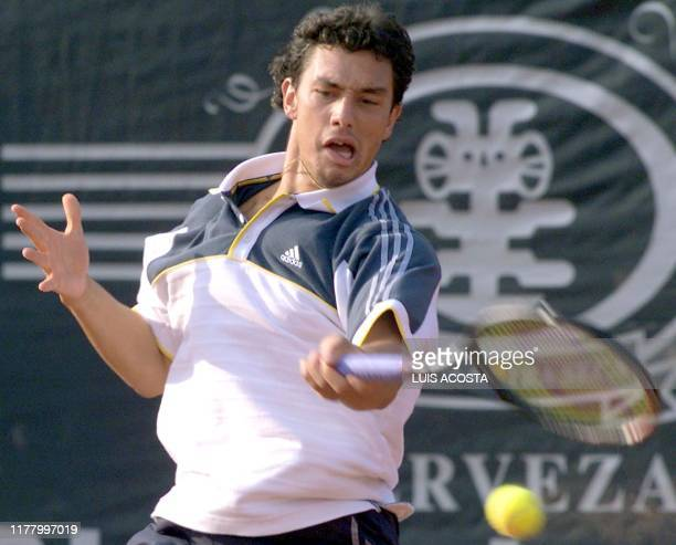 Argentine tennis player Mariano Puerta plays the Brazilian opposition Gustav Kuerten during the semifinal tournement in Bogota Columbia 11 March 2000...