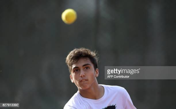Argentine tennis player Roman Burruchaga son of former footballer Jorge Burruchaga eyes the ball during a training session in Vicente Lopez Buenos...