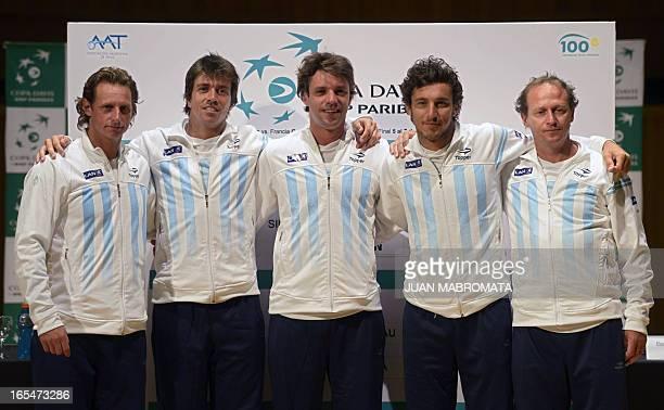 Argentine tennis players David Nalbandian Carlos Berlocq Horacio Zeballos Juan Monaco and team captain Martin Jaite pose for pictures after the draw...