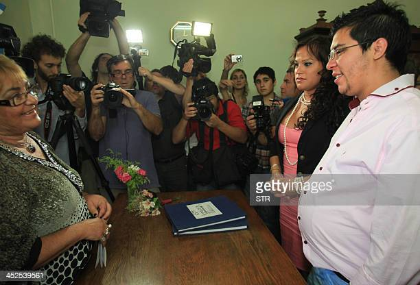 Argentine transsexual Alexis Taborda born as a woman but who changed his gender to be a man and carrying an eighmonth pregnancy marries his...