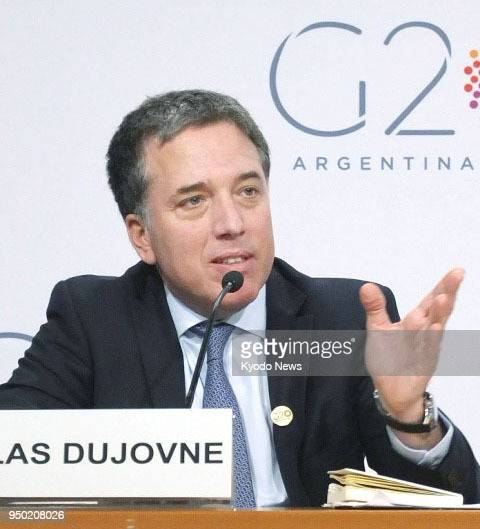 Argentine Treasury Minister Nicolas Dujovne speaks at a press conference at the International Monetary Fund's head office in Washington on April 20...